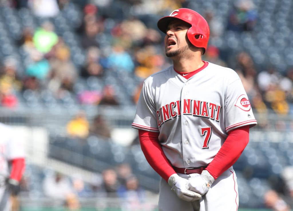 Apr 8, 2018; Pittsburgh, PA, USA;  Cincinnati Reds third baseman Eugenio Suarez (7) reacts after being hit on the hand with a pitch against the Pittsburgh Pirates during the fourth inning at PNC Park. Suarez would leave the game. Mandatory Credit: Charles LeClaire-USA TODAY Sports