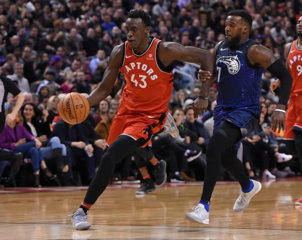 Apr 8, 2018; Toronto, Ontario, CAN;   Toronto Raptors forward Pascal Siakam (43) dribbles the ball away from Orlando Magic guard Shelvin Mack (7) in the second half at Air Canada Centre. Mandatory Credit: Dan Hamilton-USA TODAY Sports