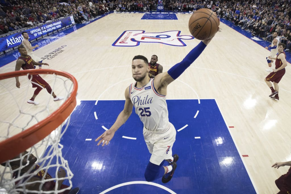 PHILADELPHIA, PA - APRIL 6: Ben Simmons #25 of the Philadelphia 76ers dunks the ball past LeBron James #23 of the Cleveland Cavaliers in the second quarter at the Wells Fargo Center on April 6, 2018 in Philadelphia, Pennsylvania. The 76ers defeated the Cavaliers 132-130. NOTE TO USER: User expressly acknowledges and agrees that, by downloading and or using this photograph, User is consenting to the terms and conditions of the Getty Images License Agreement. (Photo by Mitchell Leff/Getty Images)