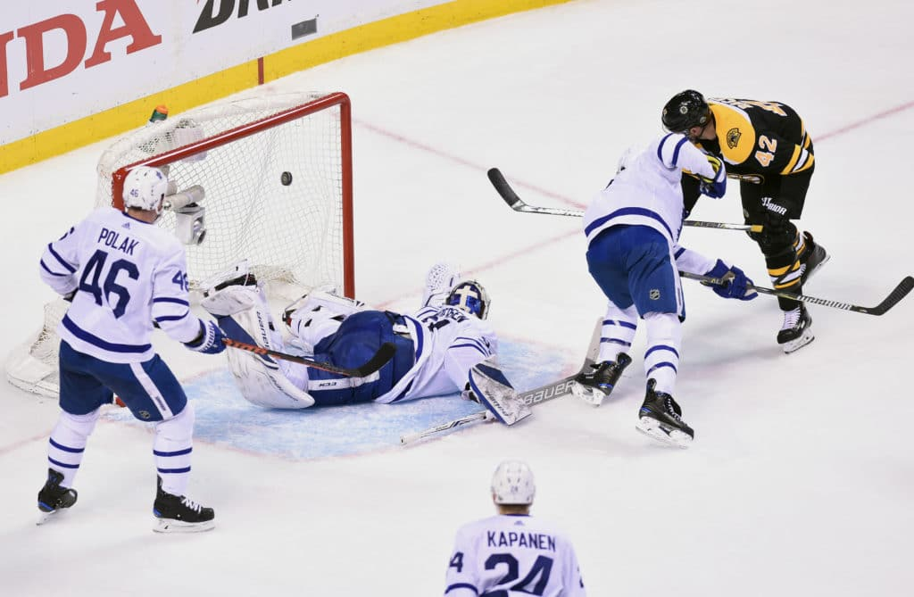 Apr 12, 2018; Boston, MA, USA; Boston Bruins right wing David Backes (42) scores a goal against Toronto Maple Leafs goaltender Frederik Andersen (31) during the second period in game one of the first round of the 2018 Stanley Cup Playoffs at TD Garden. Mandatory Credit: Bob DeChiara-USA TODAY Sports