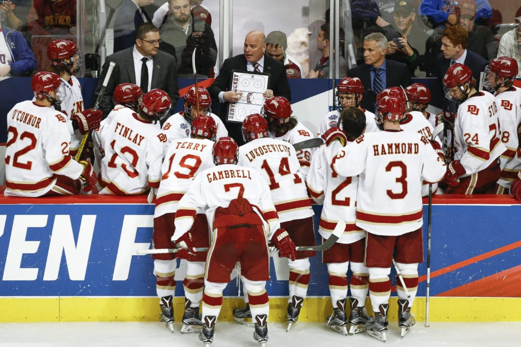 CHICAGO, IL - APRIL 06: Denver Pioneers head coach Jim Montgomery draws up plays during a timeout during the Division I Men's Ice Hockey Semifinals held at the United Center on April 6, 2017 in Chicago, Illinois. (Photo by Tim Nwachukwu/NCAA Photos via Getty Images)