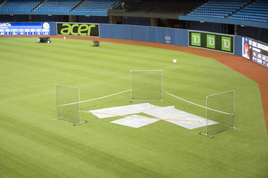 Blue Jays-Royals game postponed after falling ice damages stadium roof