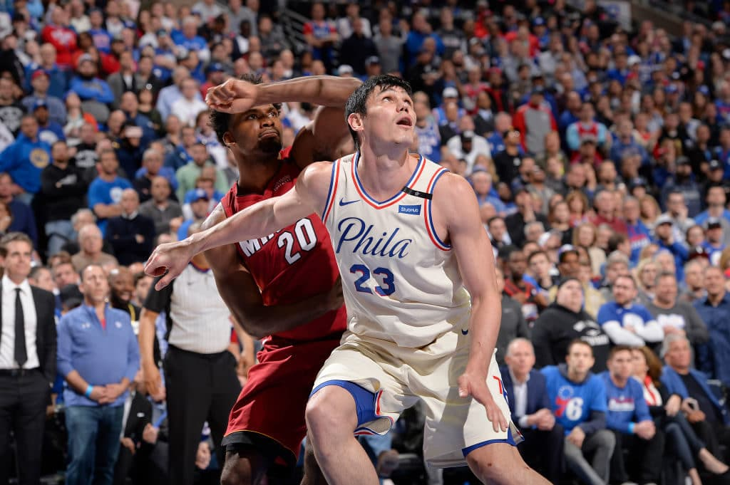 PHILADELPHIA, PA - APRIL 16: Ersan Ilyasova #23 of the Philadelphia 76ers boxes out against Justise Winslow #20 of the Miami Heat in Game Two of Round One of the 2018 NBA Playoffs on April 16, 2018 at the Wells Fargo Center in Philadelphia, Pennsylvania. NOTE TO USER: User expressly acknowledges and agrees that, by downloading and or using this Photograph, user is consenting to the terms and conditions of the Getty Images License Agreement. Mandatory Copyright Notice: Copyright 2018 NBAE (Photo by David Dow/NBAE via Getty Images)