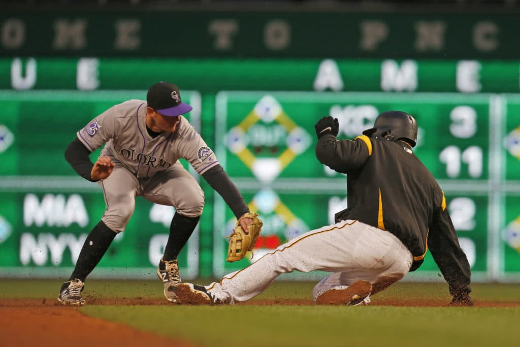 Pirates avoid sweep, blast Rockies, 10-2