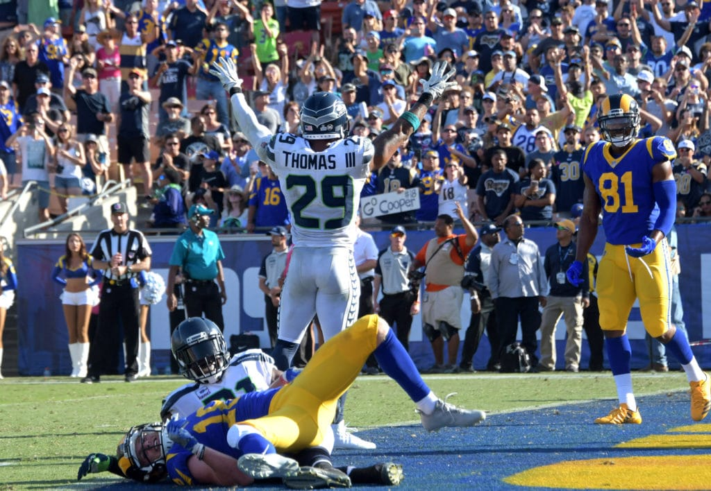 Oct 8, 2017; Los Angeles, CA, USA; Seattle Seahawks free safety Earl Thomas (29) celebrates after an incomplete pass to Los Angeles Rams wide receiver Cooper Kupp (18)  on fourth down with five seconds left during a NFL football game at Los Angeles Memorial Coliseum. The Seahawks defeated the Rams 16-10. Mandatory Credit: Kirby Lee-USA TODAY Sports