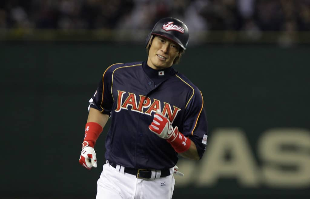 TOKYO, JAPAN - MARCH 10:  Outfielder Yoshio Itoi # 9 of Japan reacts after hits three run home run top of the fourth inning during the World Baseball Classic Second Round Pool 1 game between Japan and the Netherlands at Tokyo Dome on March 10, 2013 in Tokyo, Japan.  (Photo by Chung Sung-Jun/Getty Images)