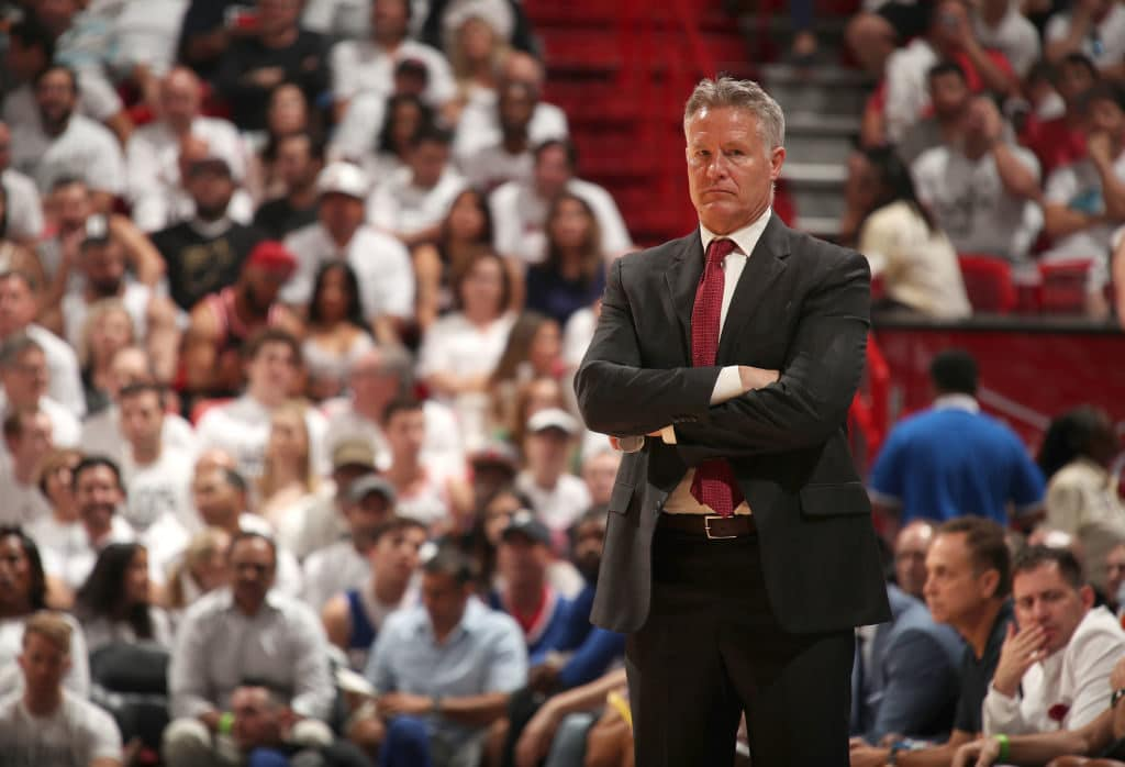 MIAMI, FL - APRIL 21: Head Coach Brett Brown of the Philadelphia 76ers looks on in Game Four of the Eastern Conference Quarterfinals against the Miami Heat during the 2018 NBA Playoffs on April 21, 2018 at American Airlines Arena in Miami, Florida. NOTE TO USER: User expressly acknowledges and agrees that, by downloading and/or using this photograph, user is consenting to the terms and conditions of the Getty Images License Agreement. Mandatory Copyright Notice: Copyright 2018 NBAE (Photo by Issac Baldizon/NBAE via Getty Images)