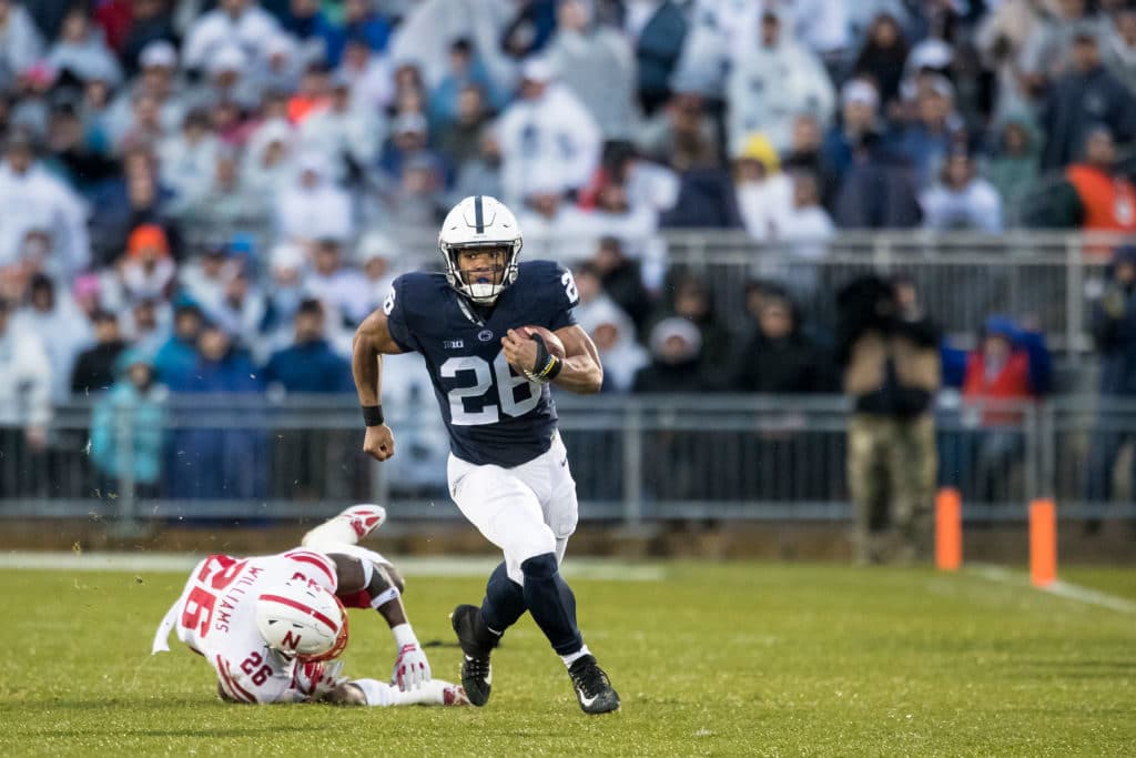 UNIVERSITY PARK, PA - NOVEMBER 18:  Saquon Barkley #26 of the Penn State Nittany Lions slips by Kieron Williams #26 of the Nebraska Cornhuskers during a touchdown run during the first quarter on November 18, 2017 at Beaver Stadium in University Park, Pennsylvania.  (Photo by Brett Carlsen/Getty Images)