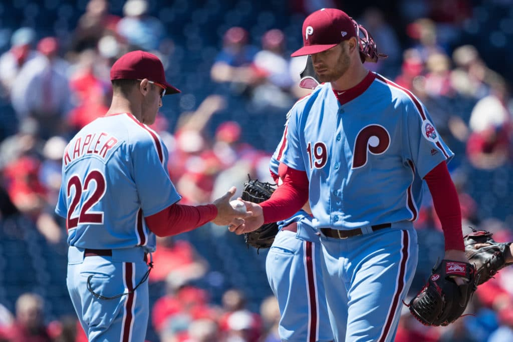 Apr 26, 2018; Philadelphia, PA, USA; Philadelphia Phillies manager Gabe Kapler (22) takes the ball from starting pitcher Ben Lively (19) for a pitching change during the third inning against the Arizona Diamondbacks at Citizens Bank Park. Mandatory Credit: Bill Streicher-USA TODAY Sports