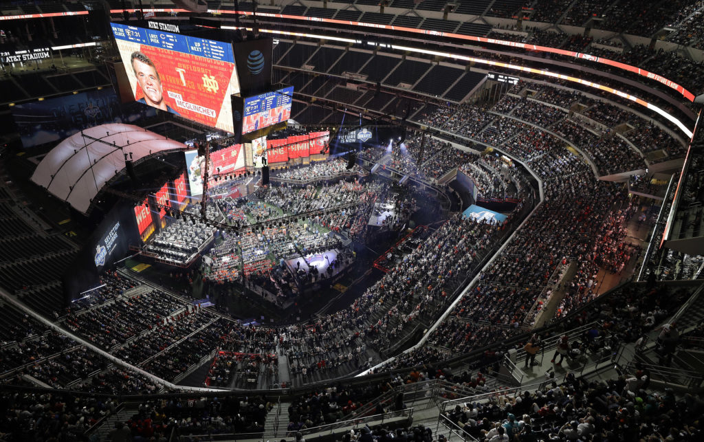 Notre Dame's Mike McGlinchey is shown on the screen at AT&T Stadium after being selected by the San Francisco Forty Niners during the first round of the NFL football draft, Thursday, April 26, 2018, in Arlington, Texas. (AP Photo/David J. Phillip)