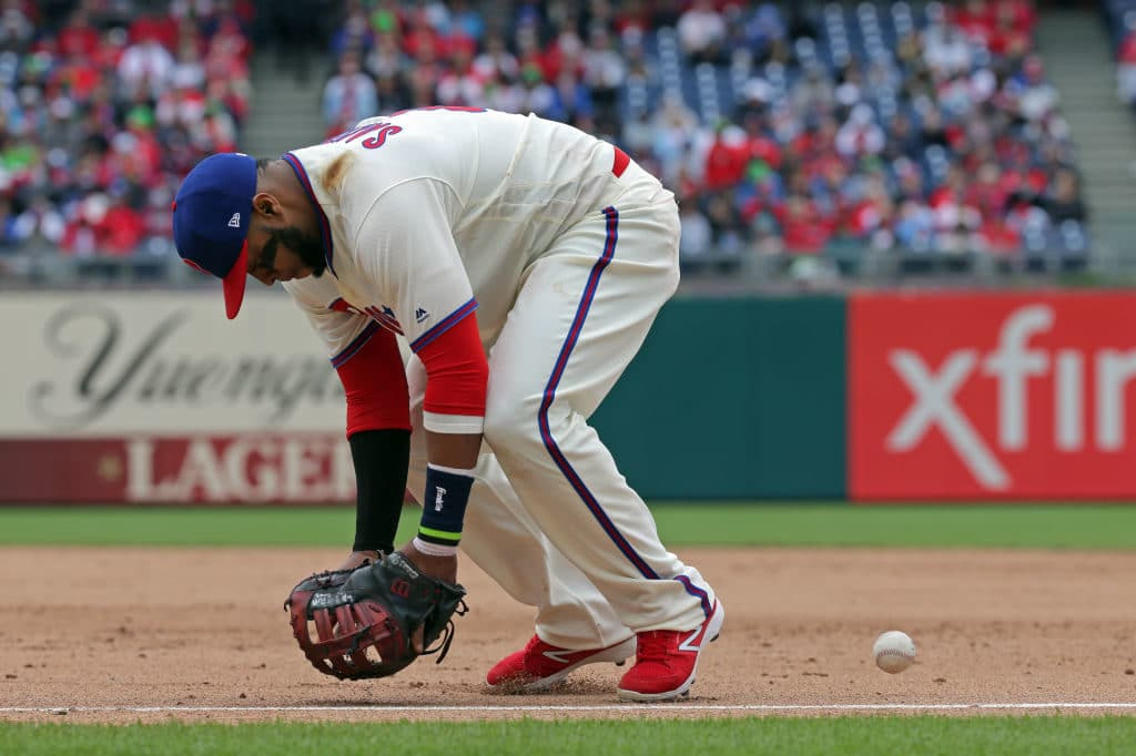 PHILADELPHIA, PA - APRIL 29: Carlos Santana #41 of the Philadelphia Phillies misplays a ground ball for an error in the sixth inning during a game against the Atlanta Braves at Citizens Bank Park on April 29, 2018 in Philadelphia, Pennsylvania. The Braves won 10-1. (Photo by Hunter Martin/Getty Images)