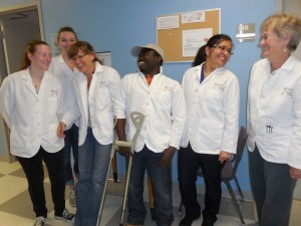 Researchers standing in a line in white lab coats