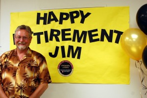 jim with his retirement sign