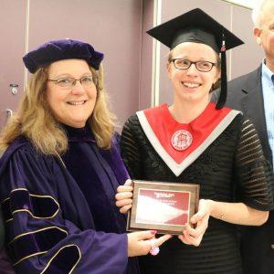 Ariane Kregger and department chair Barbara Rasco at 2017 graduation