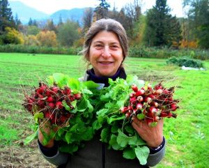 Anne Schwartz holding bunches of radishes