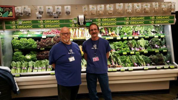CHA members in the produce section of the grocery store.