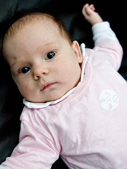 Baby in pink and white CSE onesie