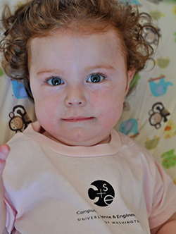 Curly-haired toddler in pink CSE t-shirt