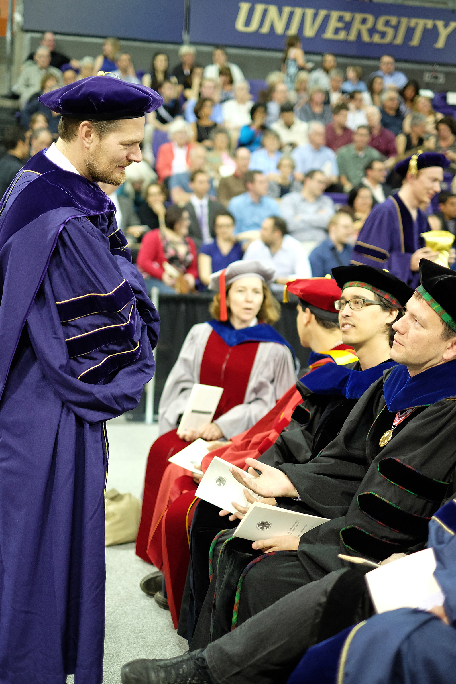 Faculty, graduates and guests at the arena