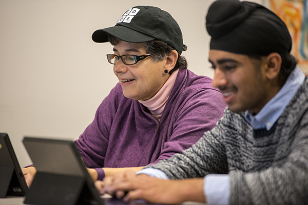 UW President Ana Mari Cauce and students participate in the Hour of Code