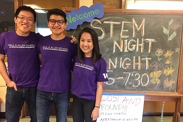 A trio of students in Allen School t-shirts who serve as CSE Ambassadors pose at a STEM Night event for high school students