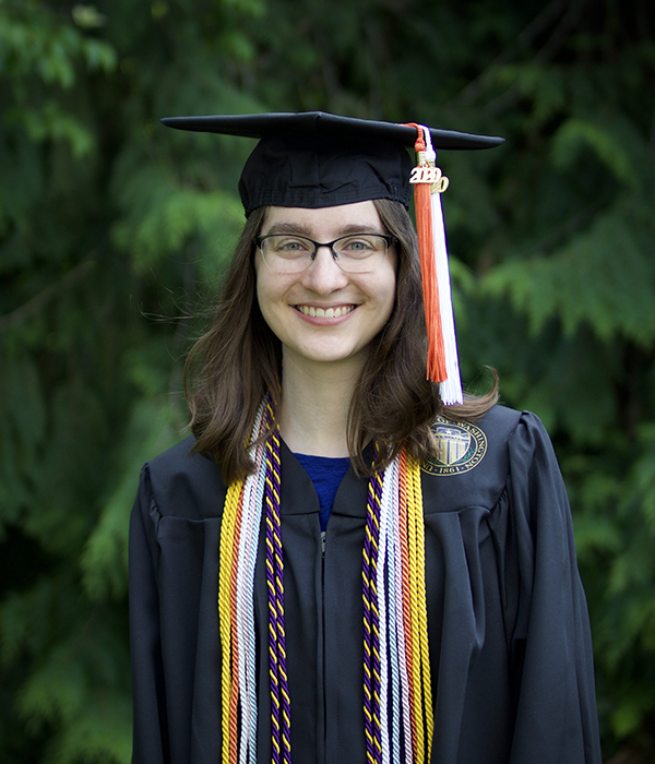 Kimberly Ruth portrait in graduation regalia