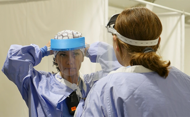 Health care workers don fabricated face shields. Photo credit: Katie Chen/UW Medicine Newsroom