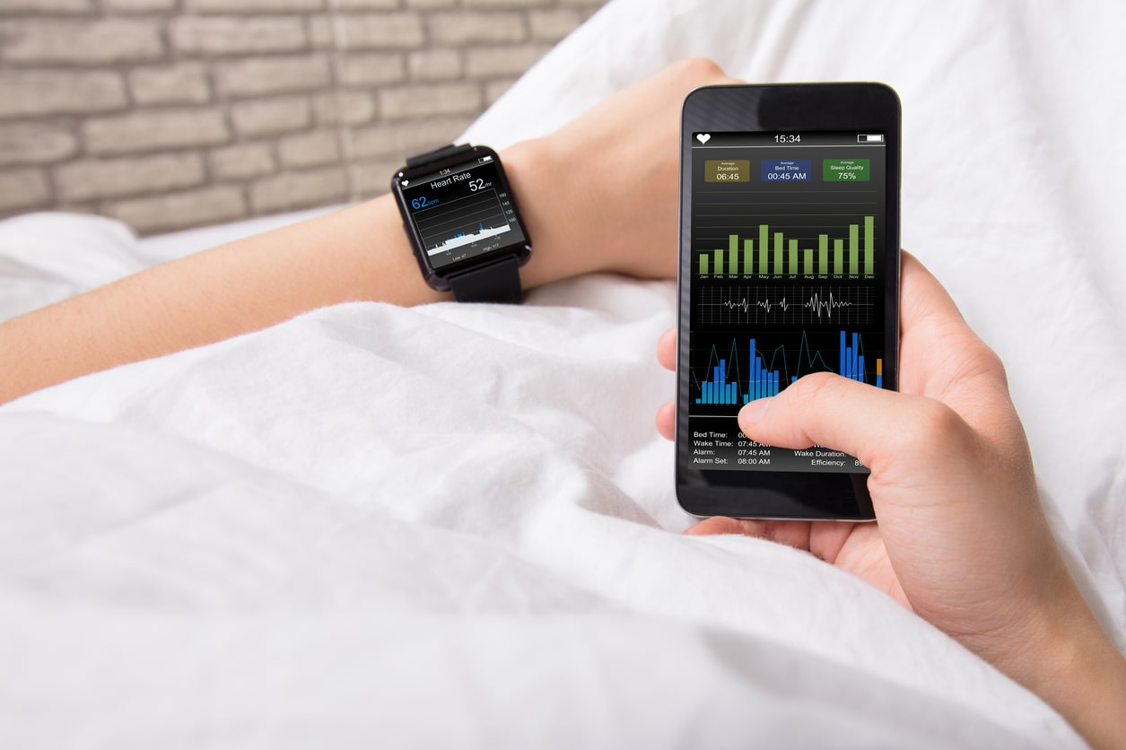 Photo of someone using a sleep tracking app with a smart watch.