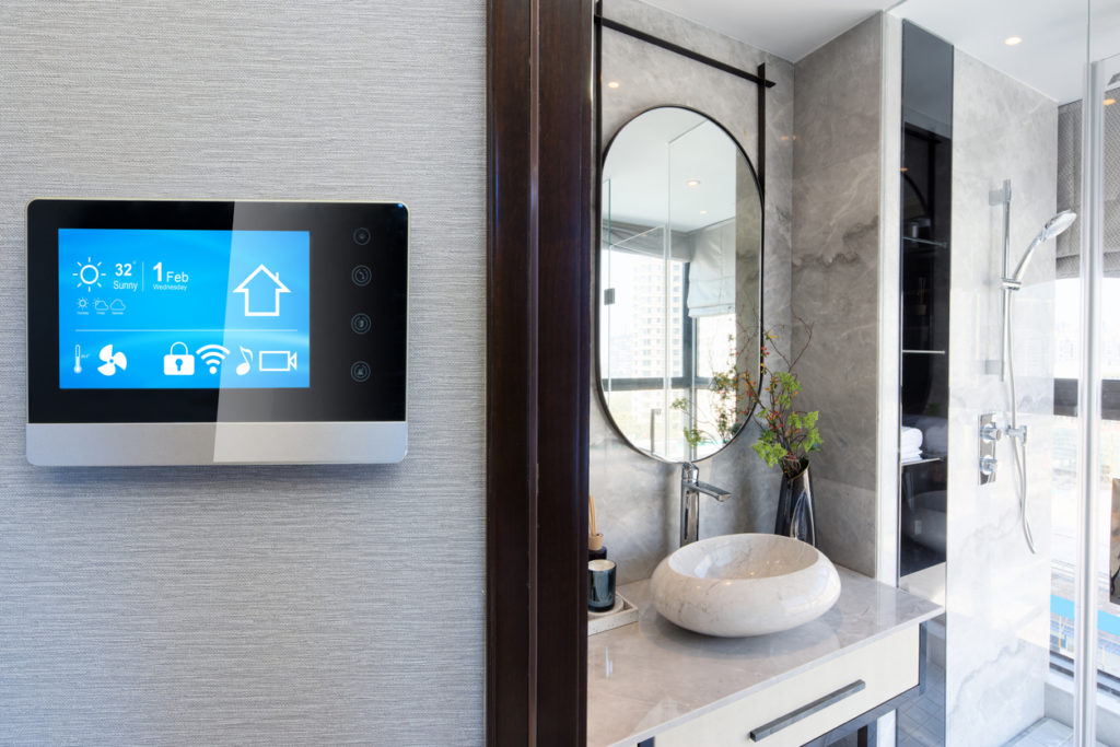 a picture of a smart bathroom and connected IoT app