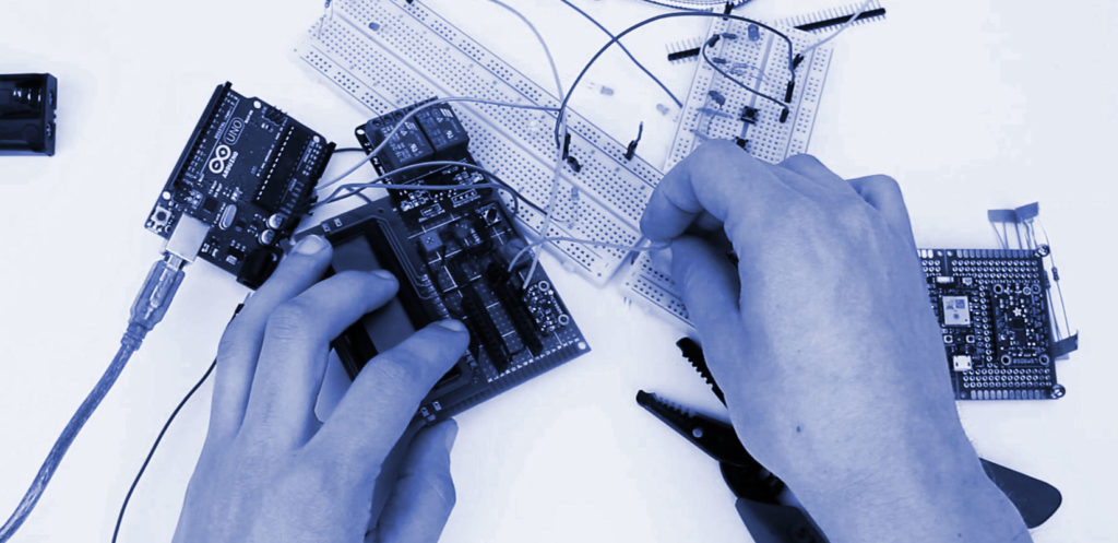 hands work on a printed circuit board prototype