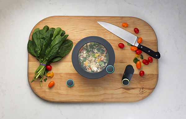 A photo of the Ovie products resting on a cutting board with vegetables