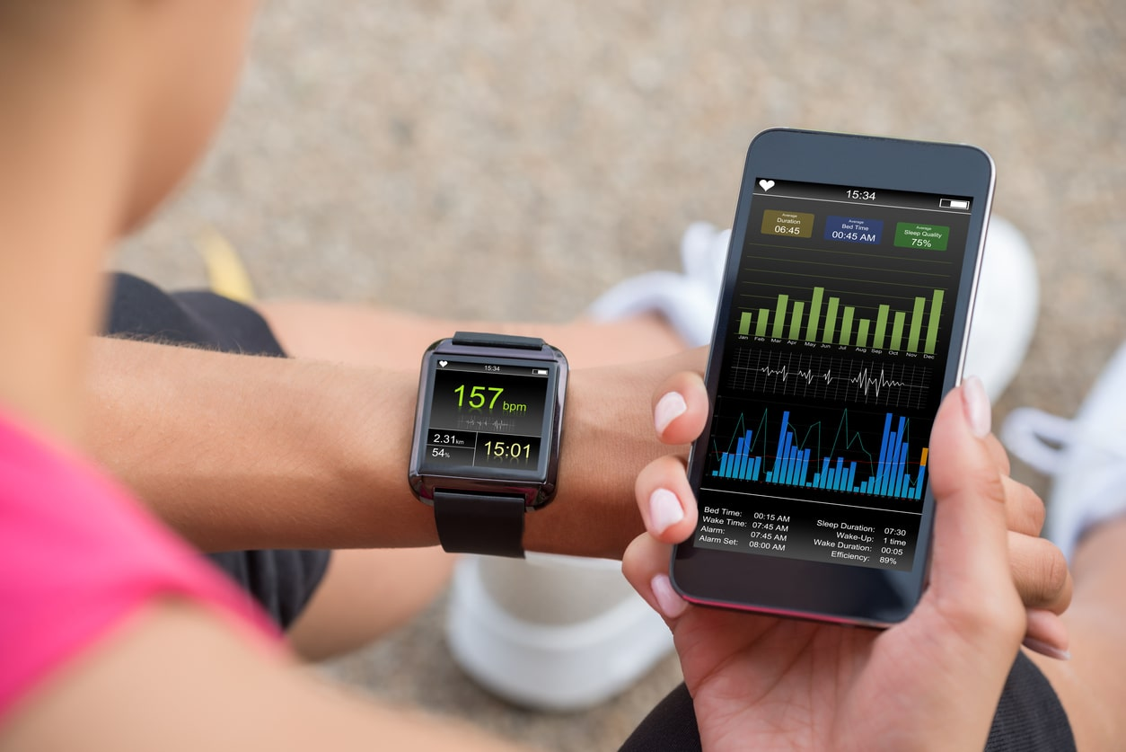 Photo of someone using a smart watch to track their workout.