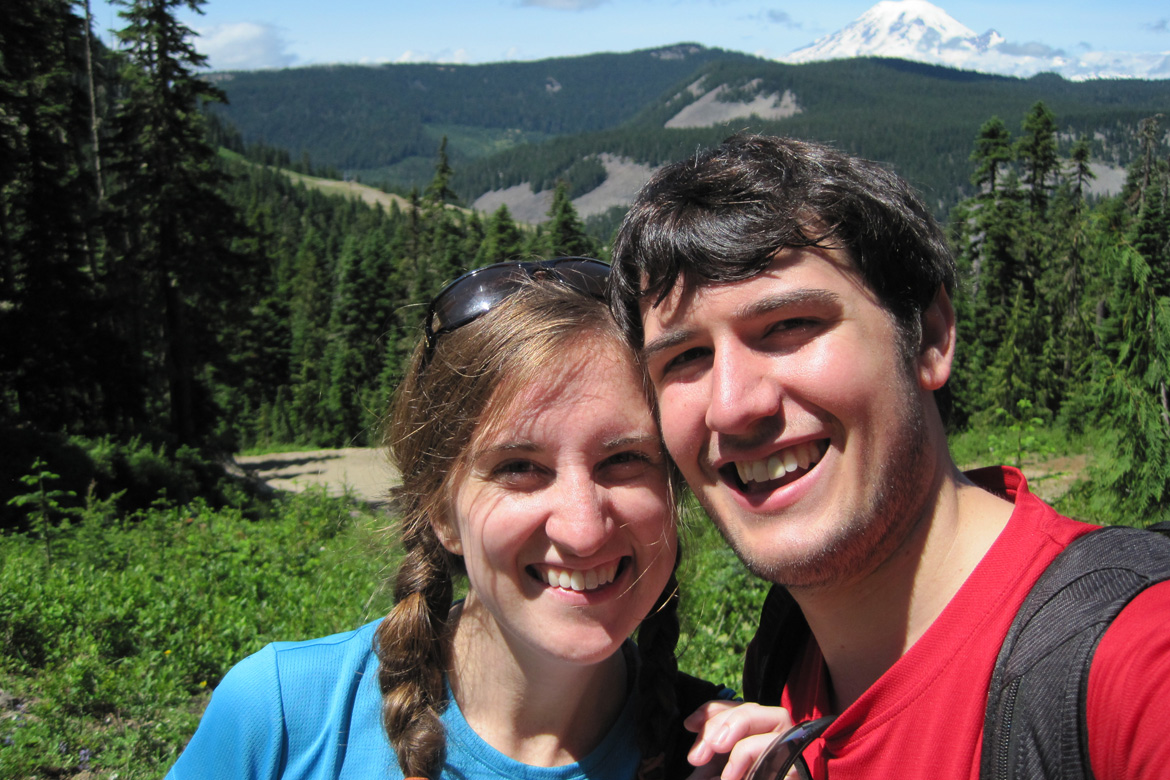 Clara and Josh on the Pacific Crest trail in 2012 with Mount Rainier in the background.