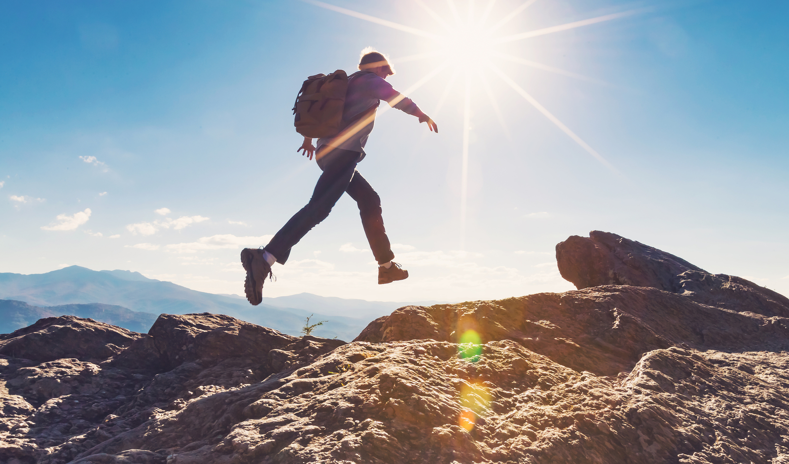 leaping over gap on a hike-start travel nursing
