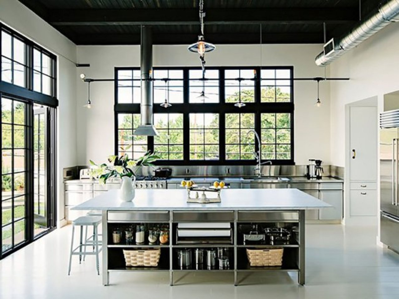 Here 39 s why you should paint your ceiling black the accent for Black industrial kitchen