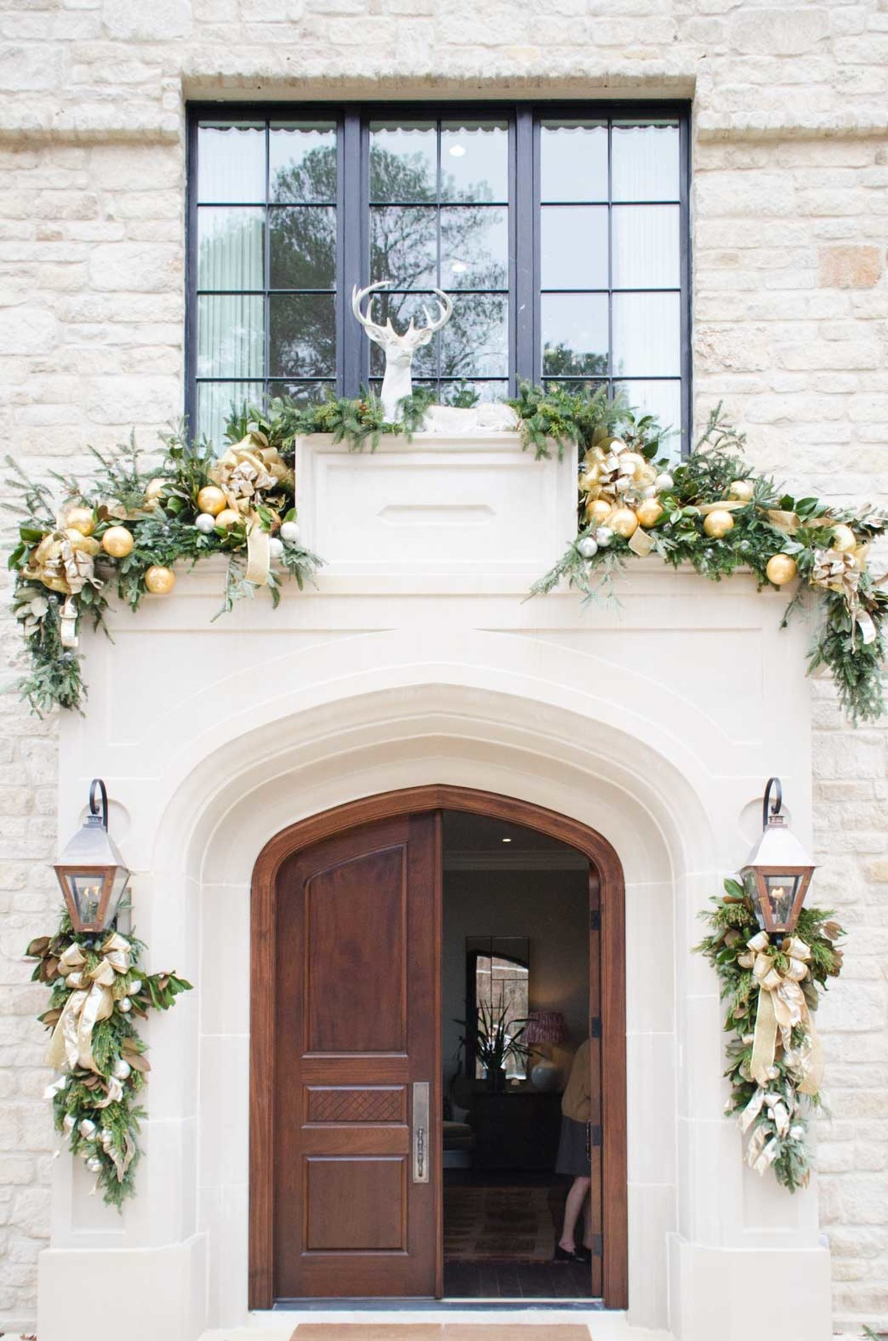 Gorgeous holiday decor on front porch of elegant Home for Holidays showhouse in Atlanta 2015 - Hello Lovely Studio