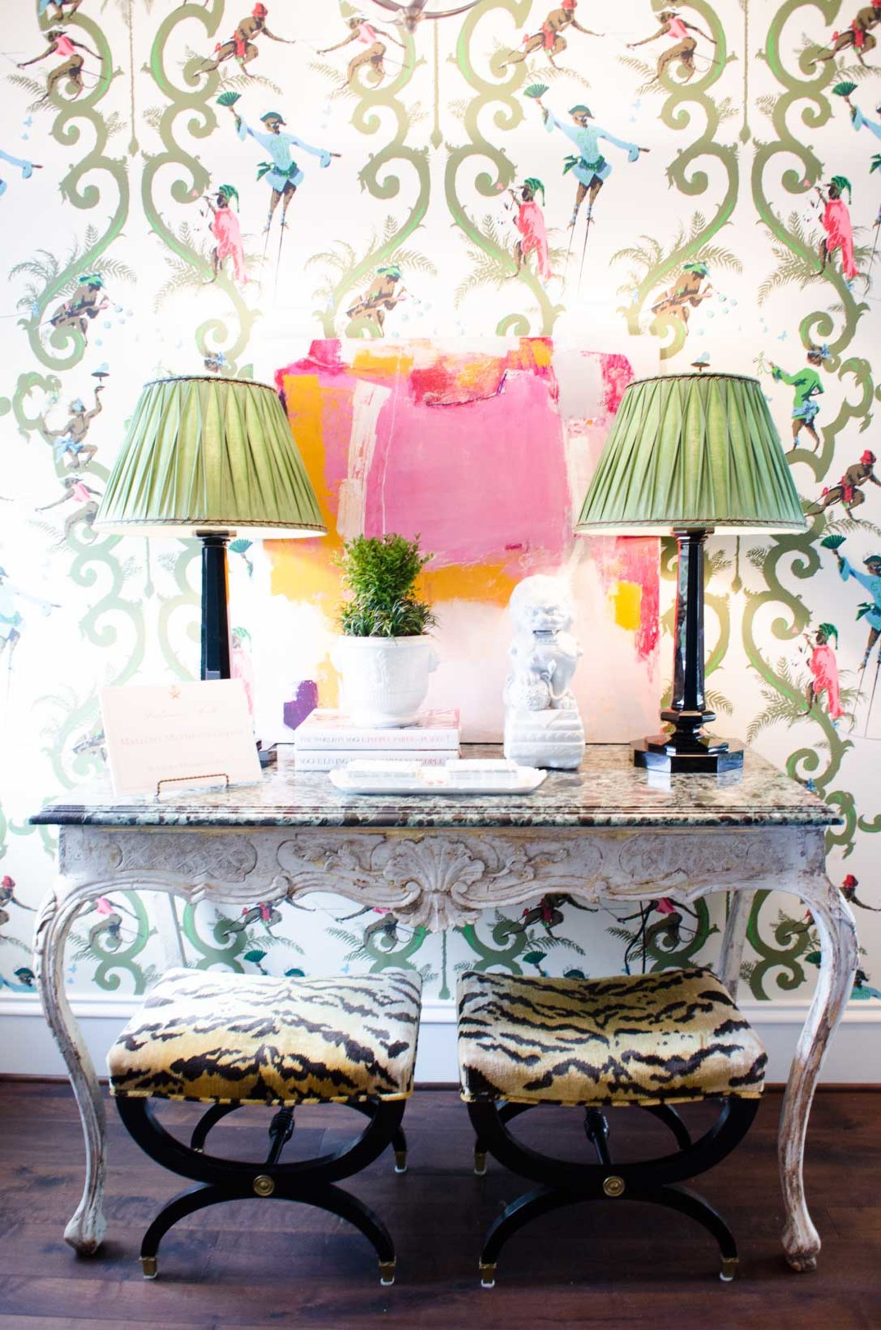 Whimsical pink and green monkey wallpaper and console table - Home for Holidays showhouse