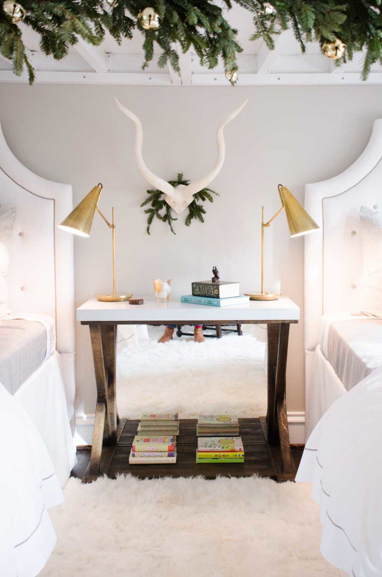 Modern brass bedside lamps, antlers, and twin beds - Gorgeous Christmas decorations at elegant Home for Holidays showhouse in Atlanta - Hello Lovely Studio