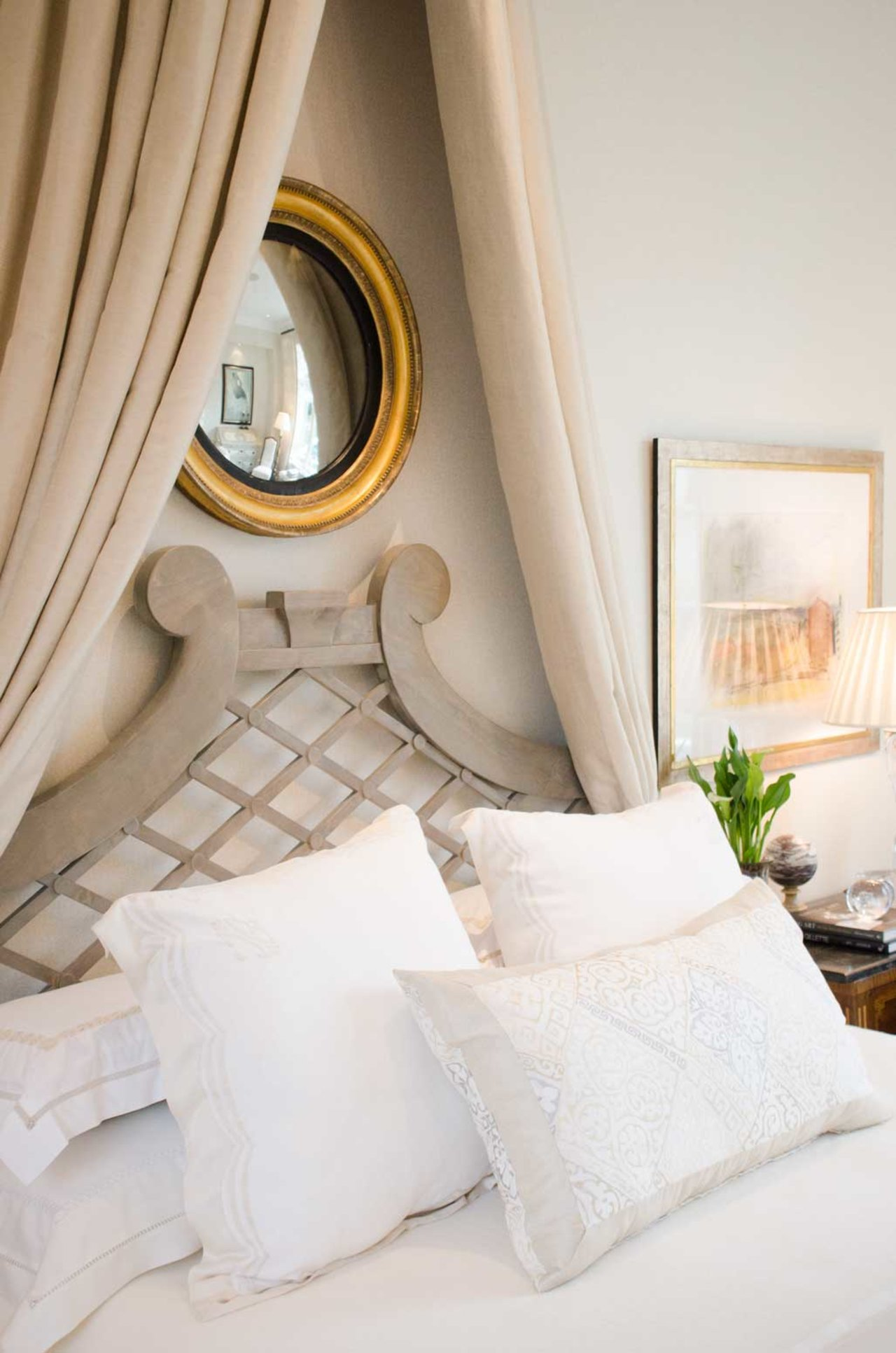 Elegant bed with canopy and round mirror - Gorgeous Christmas decorations at elegant Home for Holidays showhouse in Atlanta - Hello Lovely Studio
