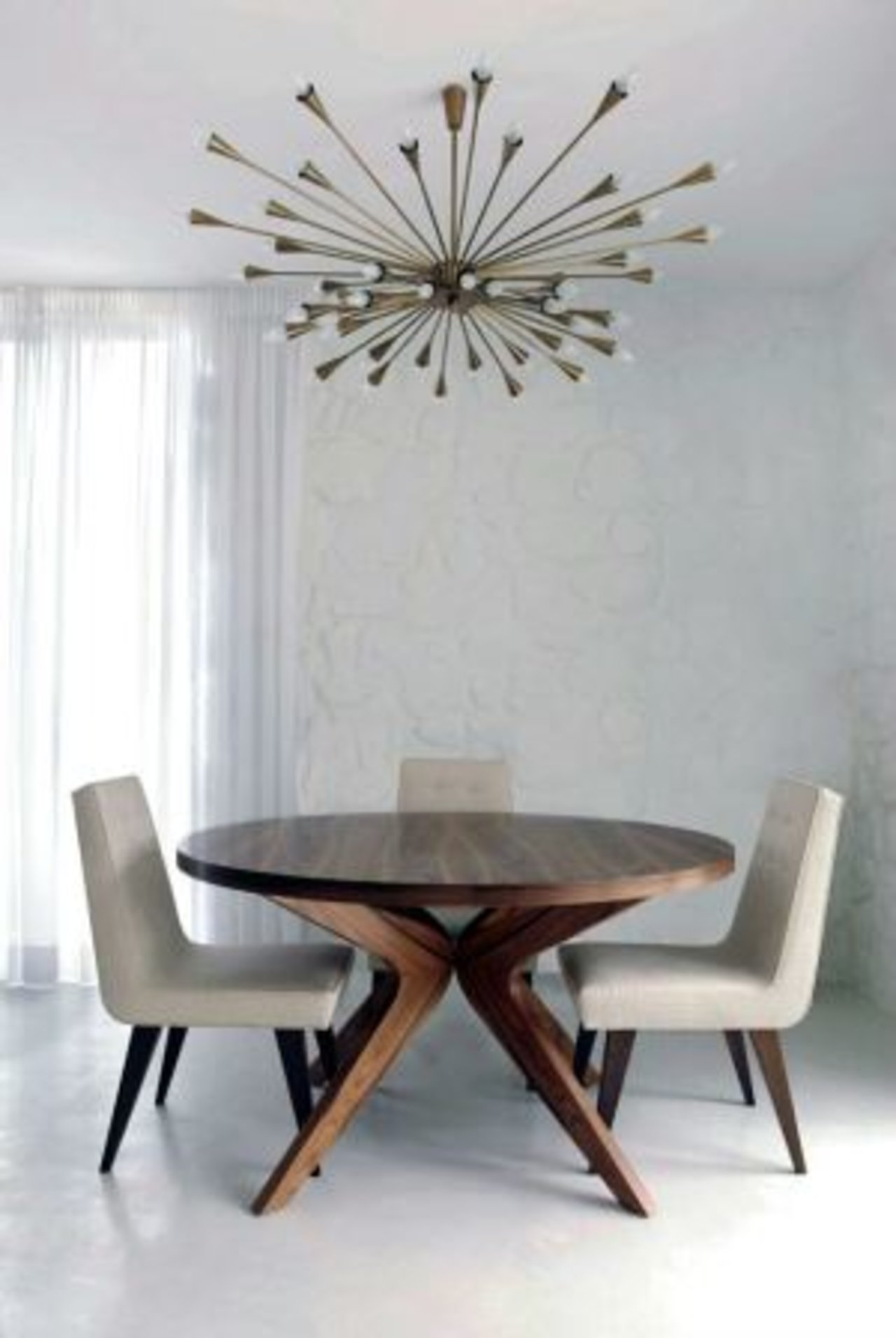 Modern dining room with Sputnik chandelier by Ross Cassidy