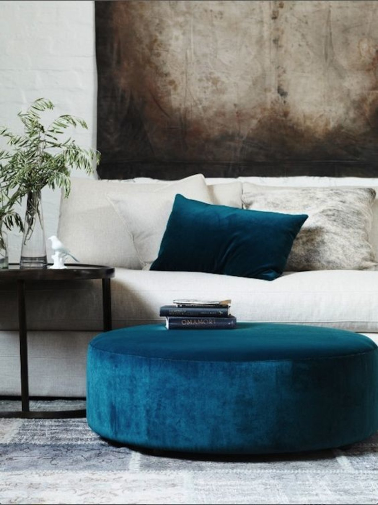 Use An Ottoman As A Coffee Table