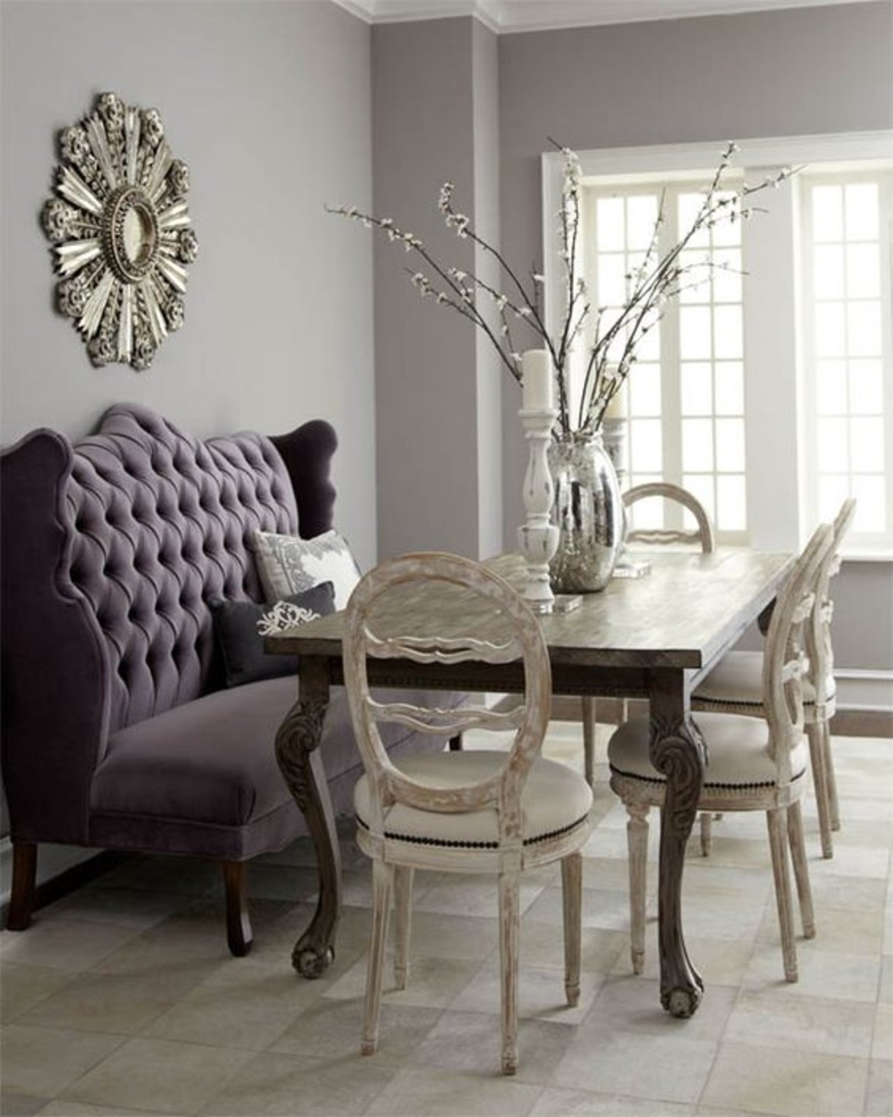 Plush Velvet Chairs And A Large Gray Bench Perfectly Accent A Shiny Mirror Dining  Table.