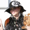 Phoebe Price Flashes The Peace Sign