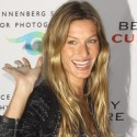 Gisele Flashes A Smile On The Red Carpet