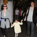 Milla Jovovich And Family At LAX