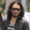 Russell Brand Wears A Leather Jacket In The Florida Heat