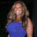 Wendy Williams Poses In Purple