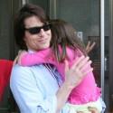 Tom Cruise Carries A Sleepy Suri