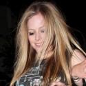 Avril Lavigne Wears Loose-Fitting Tank