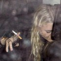 Mary-Kate Olsen Smokes In Back of SUV